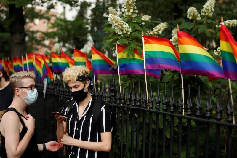 FILE PHOTO: Demonstrators take a moment while listening to speakers voice their support for gay pride and black lives matter movements in New York City