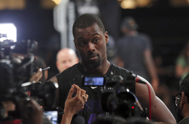 Sacramento Kings' player Harrison Barnes speaks to the media after a training session ahead of their match against Indiana Pacers for the NBA India Games 2019 in Mumbai, India, Thursday, Oct. 3, 2019. (AP Photo/Rajanish Kakade)
