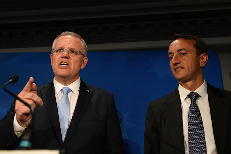 Prime Minister Scott Morrison with Liberal candidate Dave Sharma following Kerryn Phelps's win in Wentworth.