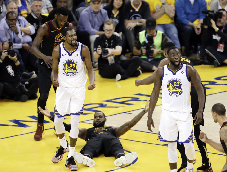Kevin Durant and LeBron James react to a call late in the fourth quarter of Game 1. They just don't know which call they're reacting to yet. (AP)