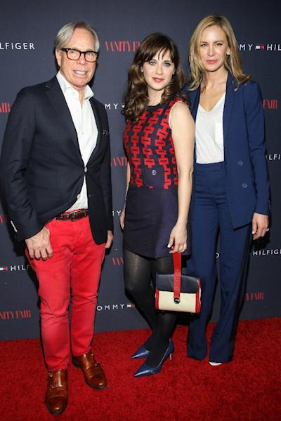 From left, Tommy Hilfiger, Zooey Deschanel and Dee Hilfiger attend the Zooey Deschanel for Tommy Hilfiger Collection launch event at The London Hotel on April 9, 2014 in West Hollywood, California. (Photo by Paul A. Hebert/Invision/AP)