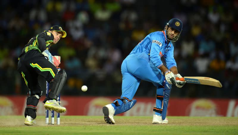 FILE PHOTO: India's Pathan gets the ball past Australia's Wade during the ICC World Twenty20 Super 8 cricket match at the R Premadasa Stadium in Colombo