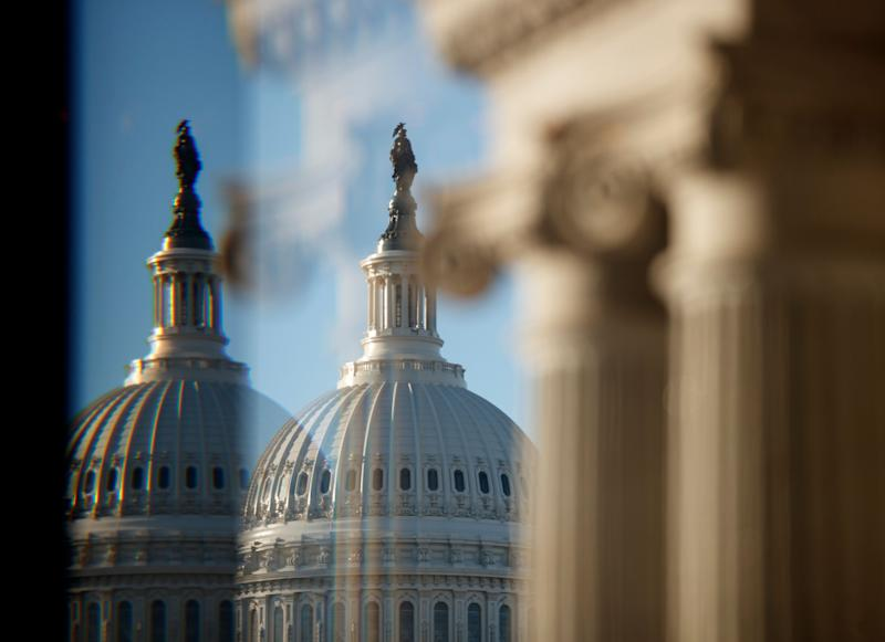 "The U.S. Capitol Building Dome is seen through a beveled window at the Library of Congress in Washington, Wednesday, Dec. 19, 2018. President Donald Trump this week appears likely to pass up his last, best chance to secure funding for the ""beautiful"" wall he's long promised to construct along the U.S.-Mexico border. (AP Photo/Carolyn Kaster)"