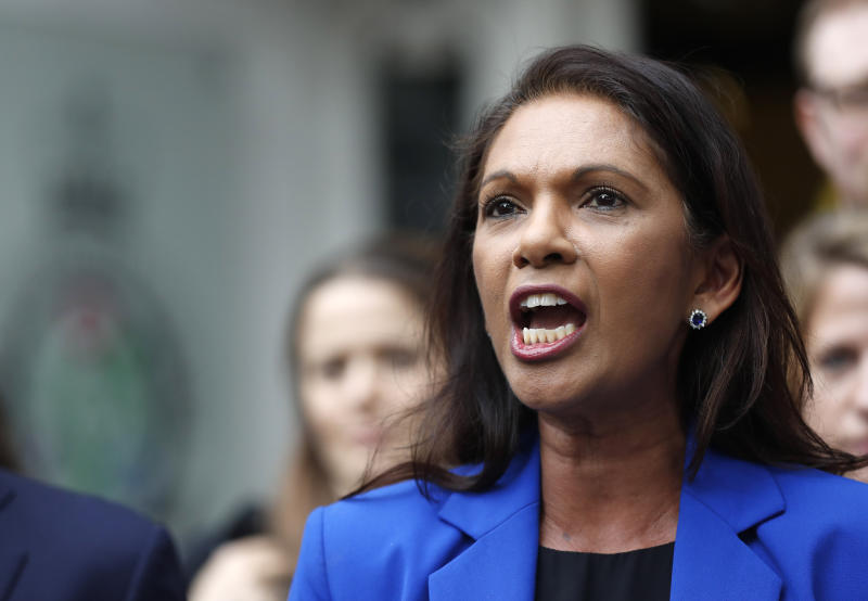 Anti-Brexit campaigner Gina Miller speaks outside the Supreme Court in London, Tuesday, Sept. 24, 2019 after it made it's decision on the legality of Prime Minister Boris Johnson's five-week suspension of Parliament. In a setback for Johnson, Britain's Supreme Court has ruled that the suspension of Parliament was illegal. The ruling Tuesday is a major blow to the prime minister who had suspended Parliament for five weeks, claiming it was a routine closure. (AP Photo/Frank Augstein)