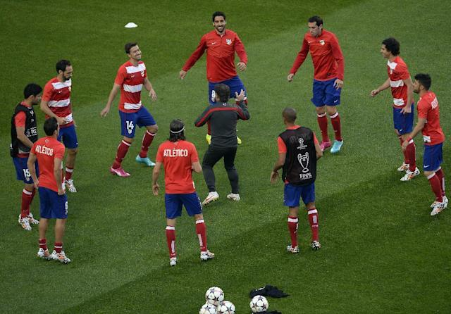Atletico players warm up prior to the Champions League final soccer match between Atletico Madrid and Real Madrid in Lisbon, Portugal, Saturday, May 24, 2014. (AP Photo/Paulo Duarte)