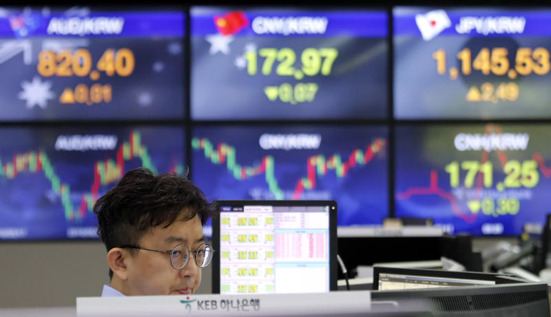 A currency trader watches monitors at the foreign exchange dealing room of the KEB Hana Bank headquarters in Seoul, South Korea, Thursday, Aug. 8, 2019. Asian stocks rebounded Thursday after Wall Street eked out a gain following volatility fueled by concern fallout from the U.S.-Chinese trade war will spread. (AP Photo/Ahn Young-joon)