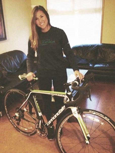 Cari Swanger poses with the first new bike she bought ahead of taking part in her first 100-mile ride. (ABC New Photo Illustration // Courtesy of Cari Swanger)