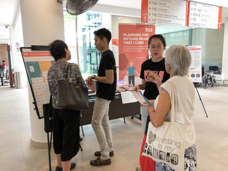 The students speaking to elderly individuals at polyclinics in Singapore (Photo: Let's Talk Care / Facebook)