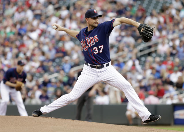 Minnesota Twins pitcher Mike Pelfrey throws against the Chicago White Sox in the first inning of a baseball game, Thursday, Aug. 15, 2013 in Minneapolis. (AP Photo/Jim Mone)