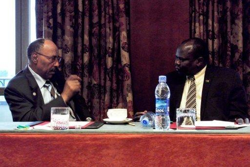 "South Sudan's negotiator Pagan Amum (right) said Juba would resume oil exports for ""reasonable"" transport fees"