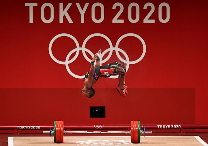 <p>Julio Ruben Mayora Pernia of Venezuela flips for joy during the weightlifting - men's 73kg Group A on day five of the Tokyo Olympic Games.</p>