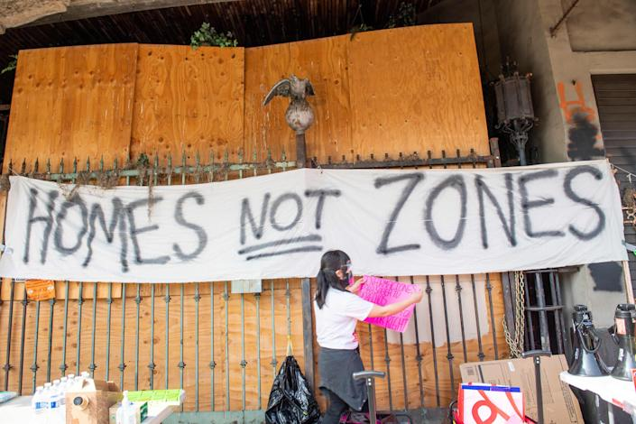 Members of the Los Angeles Tenants Union protest against evictions and give out food for the homeless on Feb. 8, 2021, in Hollywood.