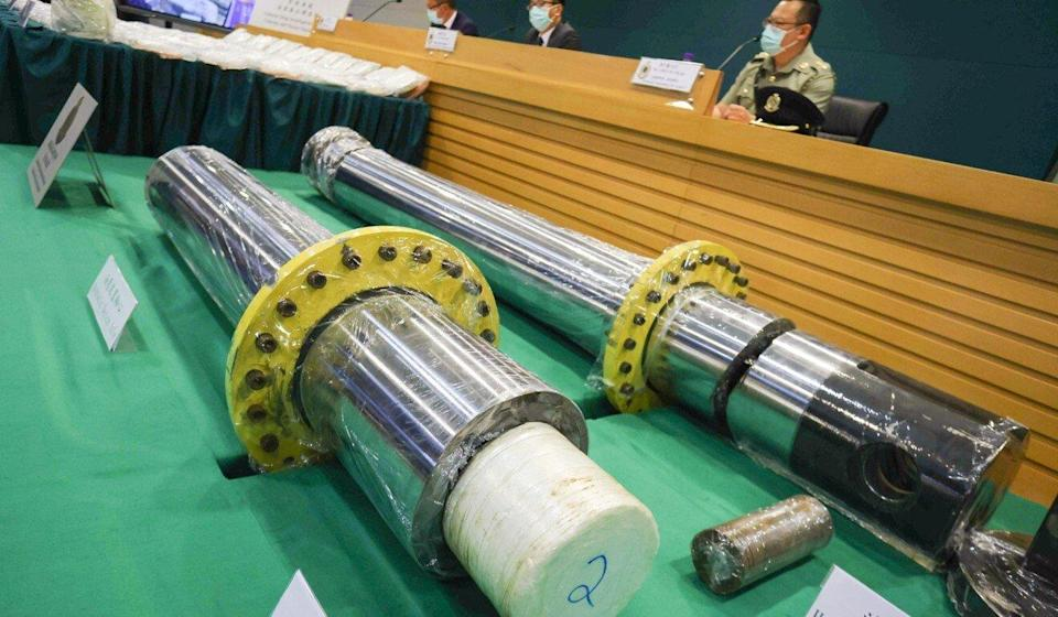 Customs officers display two hydraulic devices concealing some 110kg of cocaine during a press conference in June. Photo: May Tse
