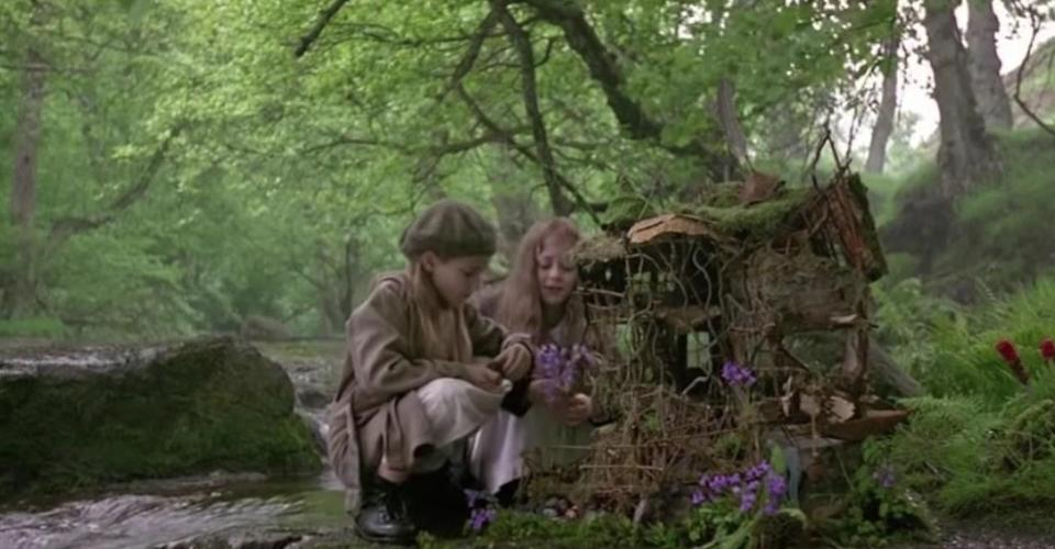 two girls in the forest near a fairy tree house