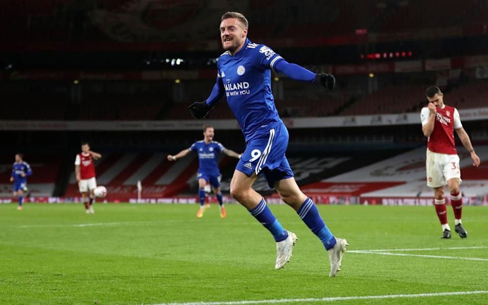 Leicester's Jamie Vardy celebrates after scoring his team's first goal during the English Premier League soccer match between Arsenal and Leicester City - GETTY