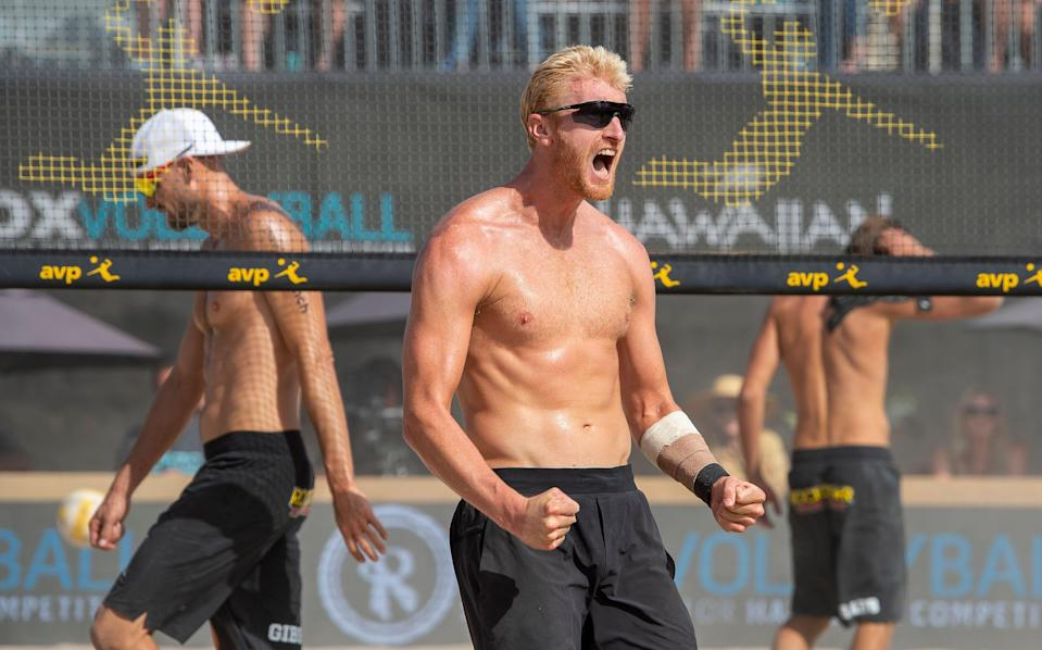 HUNTINGTON BEACH, CA - MAY 05: Chase Budinger, center, reacts after scoring against Jake Gibb, left, and Taylor Crabb, right, during the men's finals match at the AVP Huntington Beach Open in Huntington Beach on Sunday, May 5, 2019. Jake Gibb and Taylor Crabb won the match to win the tournament.  (Photo by Leonard Ortiz/MediaNews Group/Orange County Register via Getty Images)