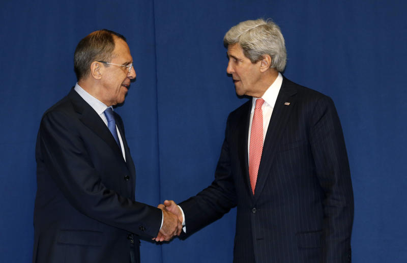 Secretary of State John Kerry shakes hands with Russian Foreign Minister Sergey Lavrov during a meeting to discuss the Ukraine crisis, Thursday, March 6, 2014, at the Conference on International Support to Libya, in Rome. It is the second meeting in as many days between Kerry and Lavrov, who met in Paris on Wednesday to talk about the crisis over the crisis in Ukraine's Crimea Peninsula. (AP Photo/Kevin Lamarque, Pool)