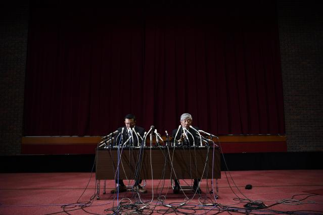 Former Nihon University's football head coach Masato Uchida, right, and assistant coach Tsutomu Inoue, left, attend a press conference in Tokyo Wednesday May 23, 2018. (Tsuyoshi Ueda/Kyodo News via AP)