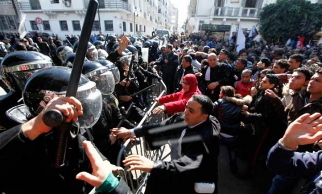 Tunisian protesters clash with riot police a day after the death of opposition leader Chokri Belaid.