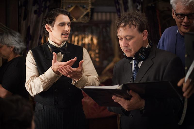 "FILE - This publicity film image released by Disney Enterprises shows James Franco, left, and director Sam Raimi on the set of ""Oz the Great and Powerful."" Returning to the mystical land of ""The Wizard of Oz"" apparently takes more than 70 years and hundreds of millions of dollars. Disney will release its anticipated prequel to the 1939 movie on Friday, Feb. 7, 2013. Directed by Raimi, ""Oz the Great and Powerful"" explores the origins of the wizard (James Franco) and the witches (Mila Kunis, Michelle Williams and Rachel Weisz) in a three-dimensional Oz. (AP Photo/Disney Enterprises, Merie Weismiller Wallace, file)"
