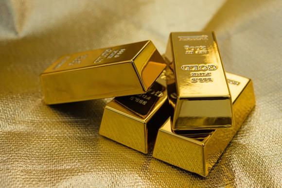 Four gold bars on a gold-colored background.