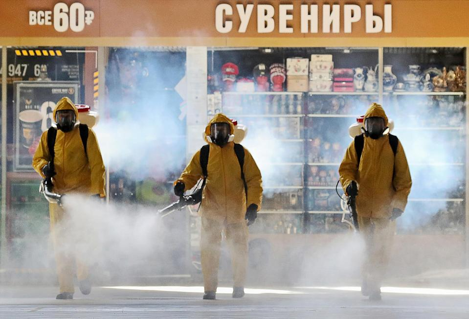 Russian Emergency Situations Ministry employees carry out the disinfection of a railway station in Moscow. (Vyacheslav Prokofyev/TASS via ZUMA Press)
