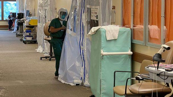 PHOTO: A medical worker wears protective clothing in the Intensive Care Unit (ICU) of St John's Regional Medical Center in Oxnard, Calif., July 9, 2020. (Sandra Stojanovic/Reuters)