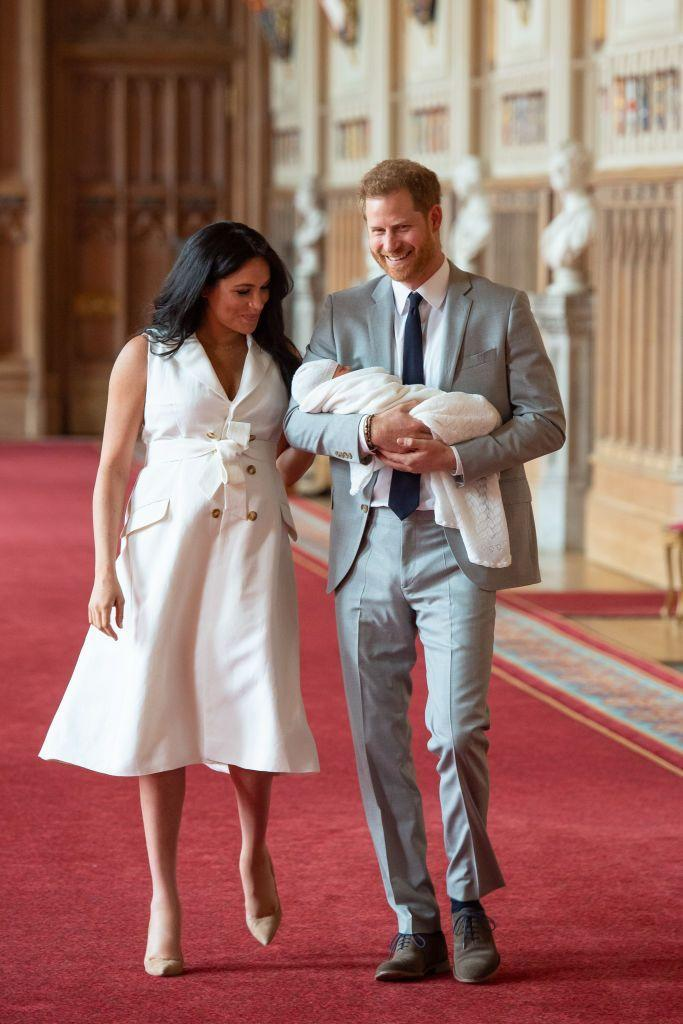 <p>Prince Harry and Meghan Markle enter St George's Hall at Windsor Castle with their new son.</p>
