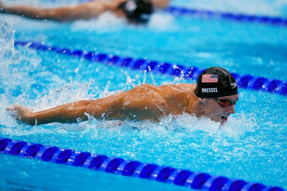 <p>The United States's Caeleb Dressel competes in the men's 4 x 100m medley relay final. Team USA took home the gold—making this one of five gold medals won by the 24-year-old swimmer at the Tokyo Games.</p>
