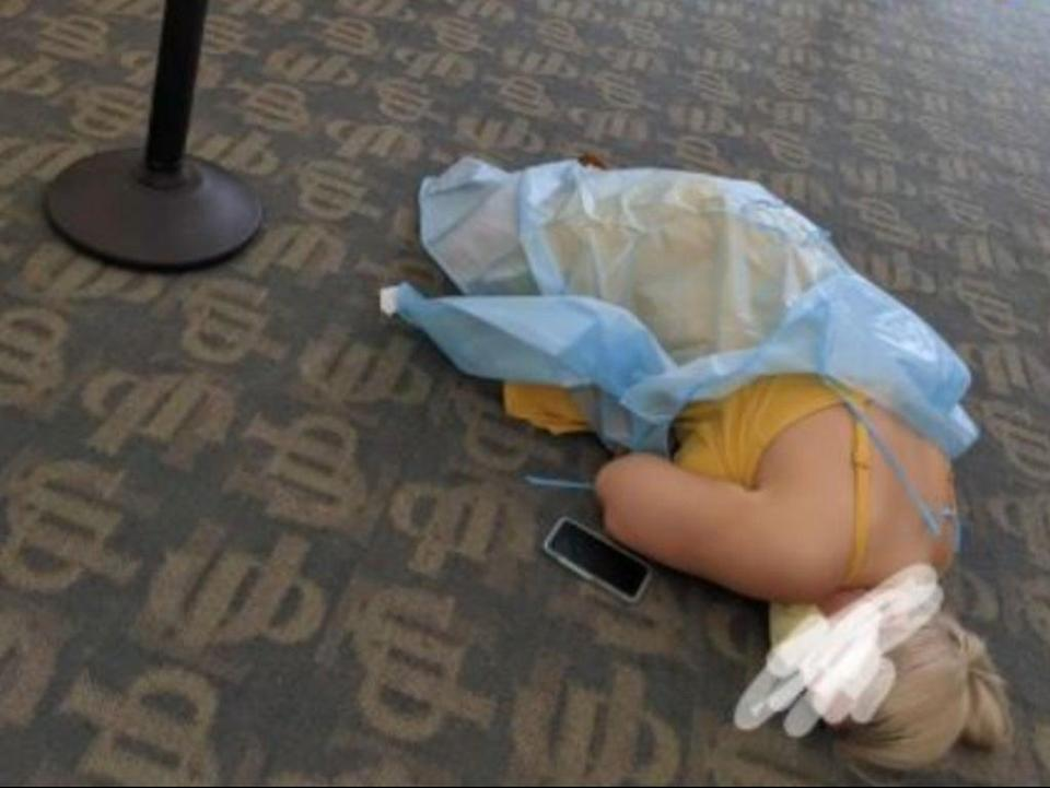 A woman suffering from Covid-19 symptoms lies on the floor of a monoclonal treatment facility in Jacksonville, Florida (Reddit screengrab)