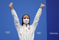 Regan Smith of the United States waves as she stands on the podium to receive her bronze medal for the women's 100-meter backstroke at the 2020 Summer Olympics, Tuesday, July 27, 2021, in Tokyo, Japan. (AP Photo/Matthias Schrader)