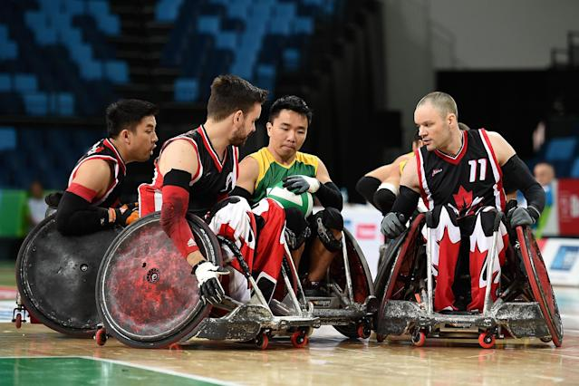 RIO DE JANEIRO, BRAZIL - FEBRUARY 26: Alexandre Keiji Taniguchi of Brazil competes against Traves Brooks Murao (L), Cody Robert Caldwell and Fabian Lavoie (R) of Canada during the International Wheelchair Rugby Championship - Aquece Rio Test Event for the Rio 2016 Paralympics match between Brazil and Canada at Olympic Park on February 26, 2016 in Rio de Janeiro, Brazil. (Photo by Buda Mendes/Getty Images)