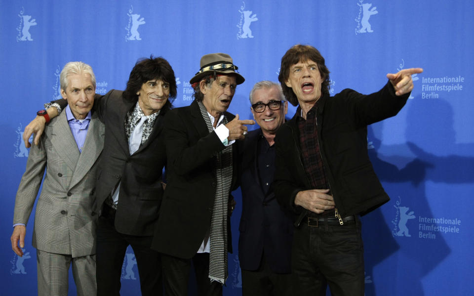 Rolling Stones Charlie Watts, Ron Wood, Keith Richards, Mick Jagger (L-R) and director Martin Scorsese (2ndR) pose during a photocall to present their film 'Shine A Light' running in competition at the 58th Berlinale International Film Festival in Berlin February 7, 2008. The 58th Berlinale, one of the world's most prestigious film festivals, will run from February 7 to 17 in the German capital.   REUTERS/Fabrizio Bensch (GERMANY)