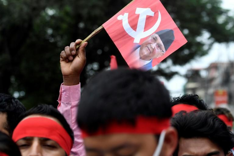Supporters of K.P. Sharma Oli chant slogans criticising the Supreme Court's decision