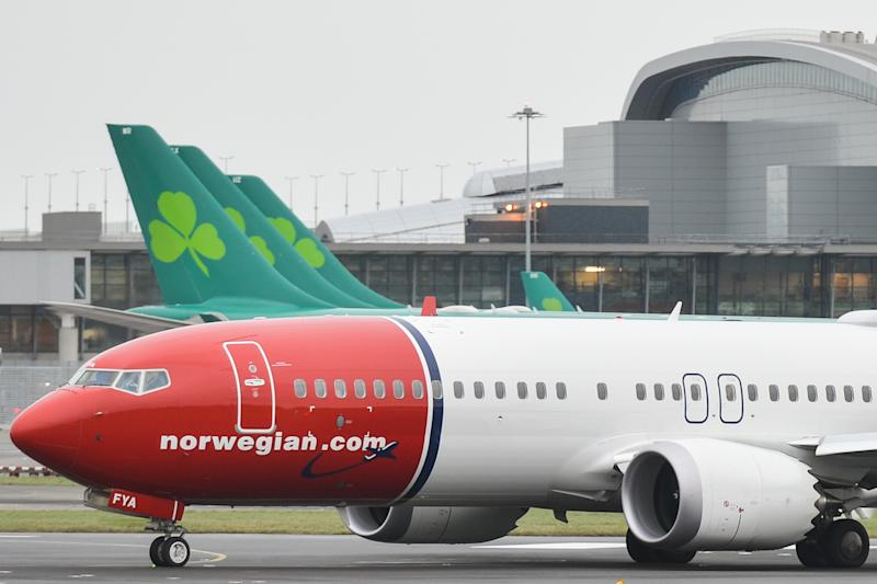 A Norwegian.com plane is about to take off on the runway at Dublin airport. On Thursday, 14 December 2017, in Dublin, Ireland. (Photo by Artur Widak/NurPhoto via Getty Images)
