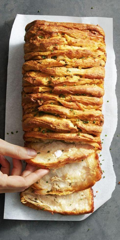 "<p>This flaky pull-apart bread, a perfect game-day snack, will have you saying ""More please!""</p><p><a href=""https://www.goodhousekeeping.com/food-recipes/a42375/buffalo-chicken-pull-apart-bread-recipe/"" rel=""nofollow noopener"" target=""_blank"" data-ylk=""slk:Get the recipe for Buffalo Chicken Pull-Apart Bread »"" class=""link rapid-noclick-resp""><em>Get the recipe for Buffalo Chicken Pull-Apart Bread »</em></a></p>"
