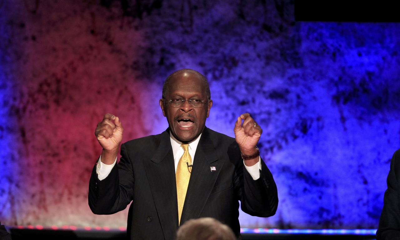 Republican presidential candidate and businessman Herman Cain makes a point while participating in a Republican presidential debate with the other hopefuls at Dartmouth College in Hanover, New Hampshire, October 11, 2011. REUTERS/Adam Hunger (UNITED STATES  - Tags: POLITICS)