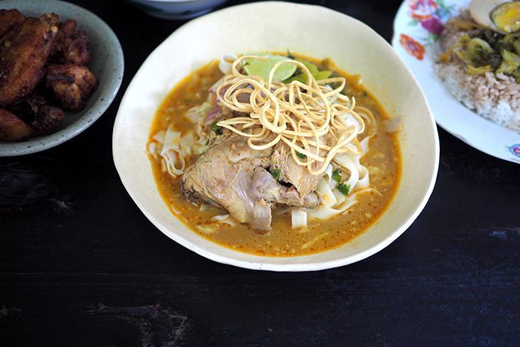 Even though the Khao Soi Ga is served with a watery broth, it is tasty plus you also get a delicious, huge piece of chicken where the meat is falling off the bone