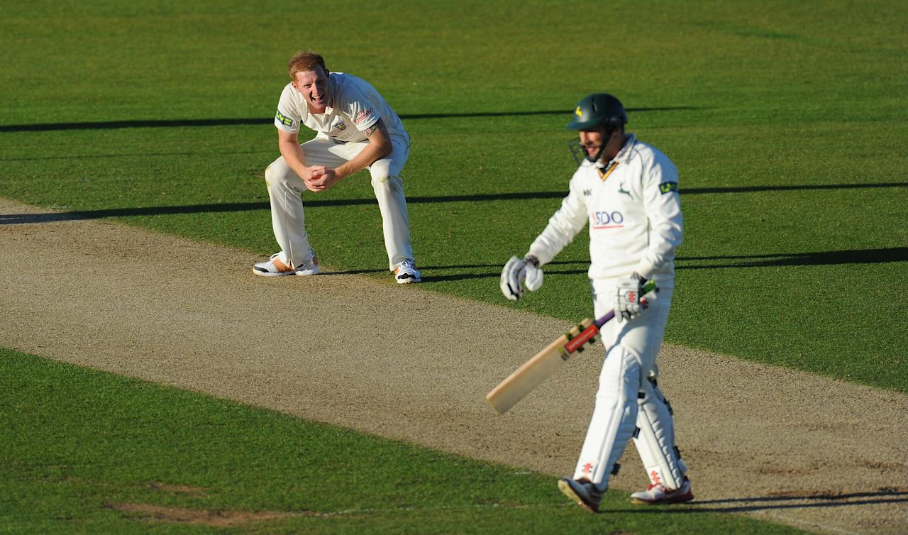CHESTER-LE-STREET, ENGLAND - SEPTEMBER 18:  Durham player Ben Stokes (l) celebrates as Notts batsman David Hussey is bowled during day two of the LV County Championship Division One match between Durham and Nottinghamshire at The Riverside on September 18, 2013 in Chester-le-Street, England.  (Photo by Stu Forster/Getty Images)