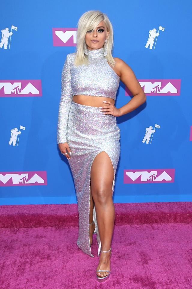"<p>For the 2018 MTV VMAs, <a href=""https://www.popsugar.com/fashion/MTV-VMAs-2018-Red-Carpet-Dresses-45169388"" class=""ga-track"" data-ga-category=""Related"" data-ga-label=""https://www.popsugar.com/fashion/MTV-VMAs-2018-Red-Carpet-Dresses-45169388"" data-ga-action=""In-Line Links"">Christian Siriano dressed Bebe</a> in a revealing silver co-ord.</p>"