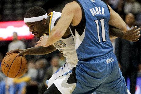 Denver Nuggets' Ty Lawson (3) drives around Minnesota Timberwolves' J.J. Barea (11) during the fourth quarter of an NBA basketball game Monday, March 3, 2014, in Denver. The Timberwolves won 132-128. (AP Photo/Barry Gutierrez)
