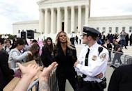 Actress Laverne Cox exits U.S. Supreme Court after arguments in LGBT case in Washington
