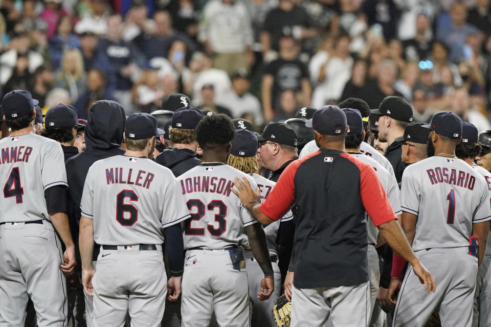 Chicago White Sox and Cleveland Indians gather after Chicago White Sox's Jose Abreu was hit by a pitch thrown by Cleveland Indians reliever James Karinchak during the eighth inning of a baseball game in Chicago, Friday, July 30, 2021. The Chicago White Sox won 6-4. (AP Photo/Nam Y. Huh)