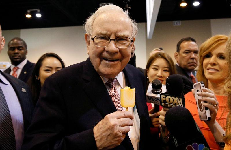 FILE PHOTO: Berkshire Hathaway chairman and CEO Warren Buffett enjoys an ice cream treat from Dairy Queen before the Berkshire's annual meeting in Omaha