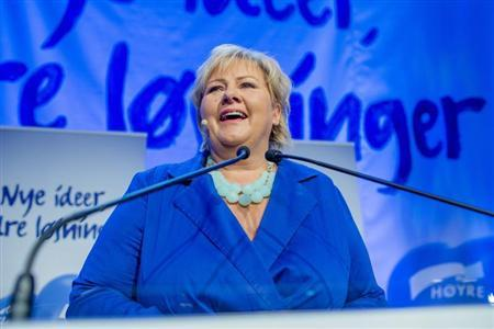 Norway's main opposition leader Solberg of Hoyre speaks to party members while waiting for the results of the general elections in Oslo