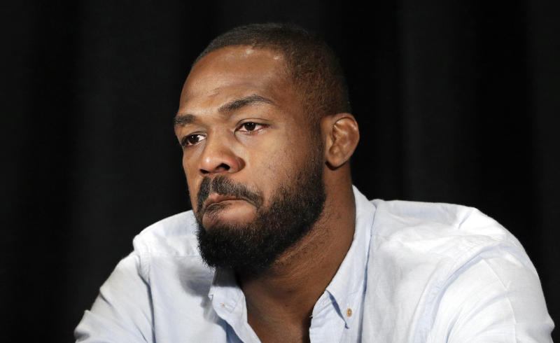 FILE - In this July 7, 2016, file photo, mixed martial arts fighter Jon Jones reacts as he speaks during a news conference in Las Vegas. Former UFC light heavyweight champion Jon Jones should be eligible to fight by late October after completing a 15-month suspension for a doping violation. The U.S. Anti-Doping Agency on Wednesday, Sept. 19, 2018 announced the length of Jones' ban for his second violation of the UFC's anti-doping policy. (AP Photo/John Locher, File)