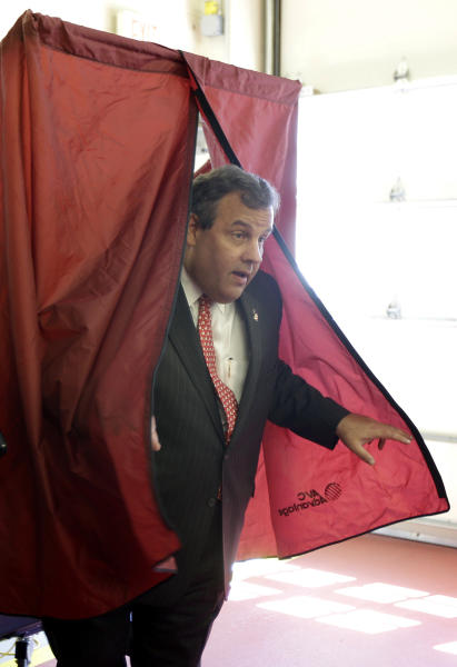 New Jersey Gov. Chris Christie comes out of a voting booth after casting his primary election vote at the Mendham Township emergency services building, Tuesday, June 4, 2013, in Mendham Township, N.J. (AP Photo/Julio Cortez)