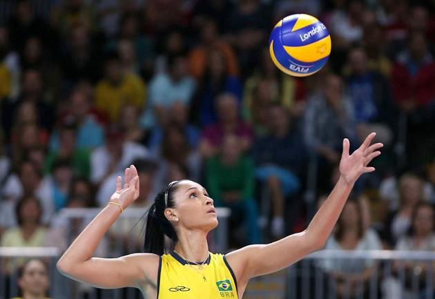 LONDON, ENGLAND - JULY 30: Jaqueline Carvalho of Brazil serves in the Women's Volleyball Preliminary match between the United States and Brazil on Day 3 of the London 2012 Olympic Games at Earls Court on July 30, 2012 in London, England.  (Photo by Elsa/Getty Images)