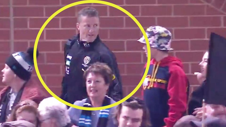 Richmond coach Damien Hardwick (pictured) turning back to respond to a fan.