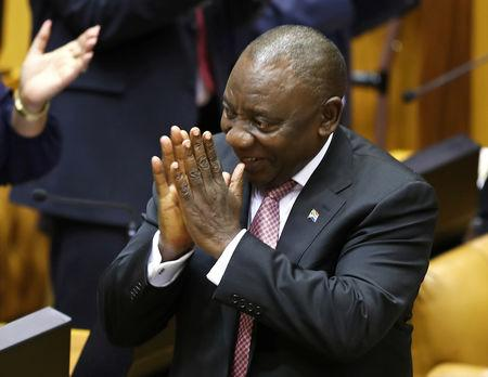 South African President Cyril Ramaphosa acknowledges the applause after Parliament elected him as President, in Cape Town